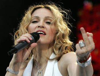 Madonna giving poverty the middle finger